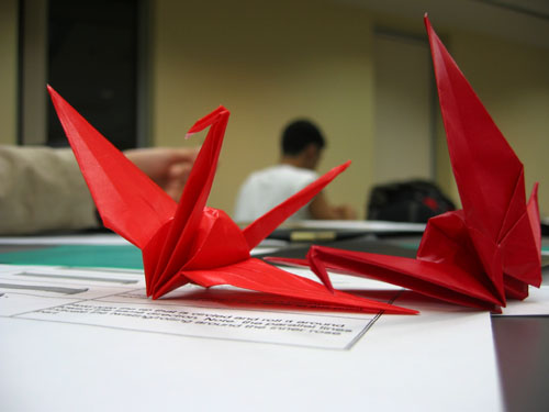 Two red paper cranes.