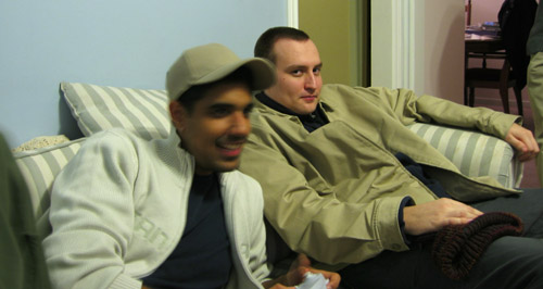 Dave and Rishi playing video games in my living room.