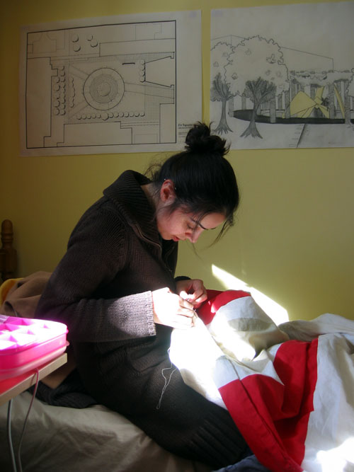 Shima still sewing in her room.