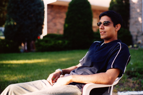 Rishi sitting in front of my house.