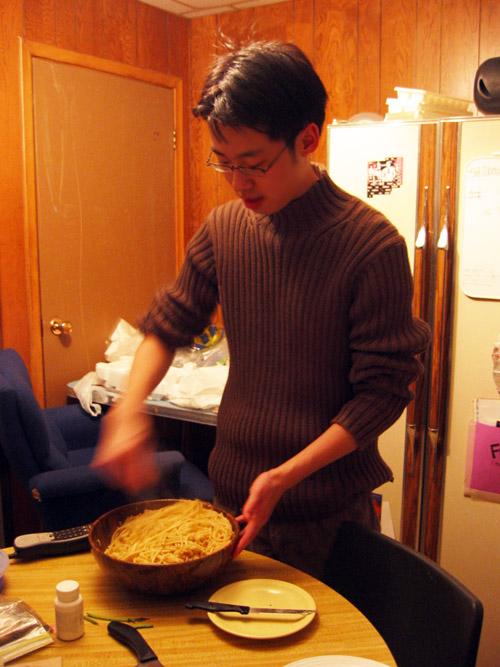 Matt stirring the pasta.