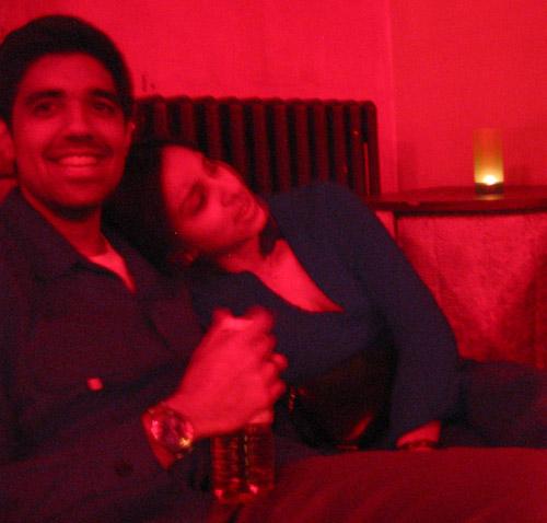 Rishi and Sheliza sitting on the corner sofa in IV lounge.
