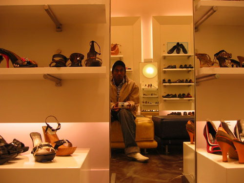 Myself, sitting in a shoe store.