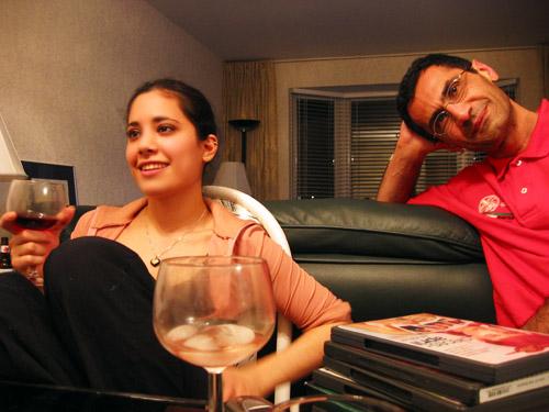 Nina and Riadh sitting in Riadh's dining room.