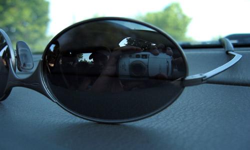 My Oakleys sitting on the dash of a car.