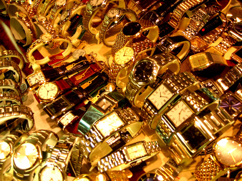 A lot of watches in a display case at Woodside Square.