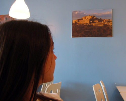 Shima in Shandiz, looking at a picture of Iran.