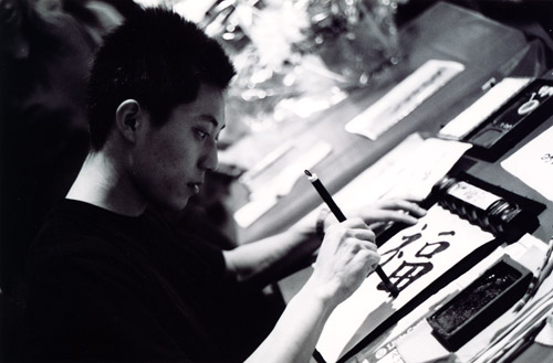 Toshi writing something in Japanese.