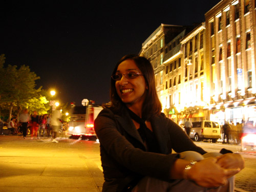 Sheliza sitting in old Montreal.