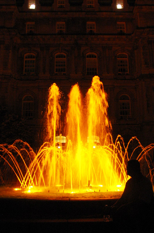 A fountain at night in downtown Montreal.