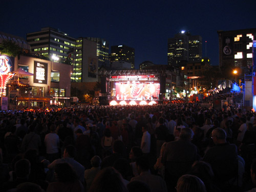 A crowd at the Montreal Jazz Festival watching Kokolo play.