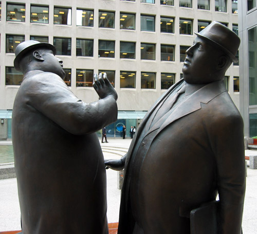 A statue of two fat men in Commerce Court.