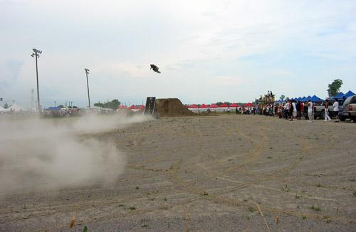 A dirt bike makes an impressive jump.
