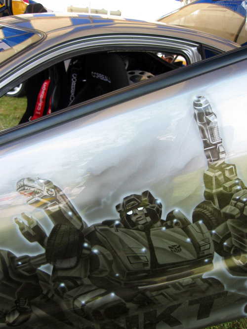 A car door painted with various Autobots.