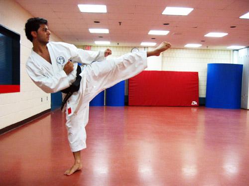 Ali doing some sort of Karate kick.