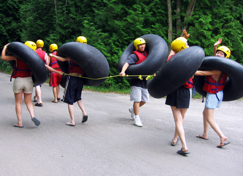 Shima's friends walking together in their tubing gear.