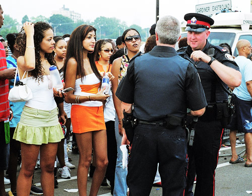 Some ladies talking to some of Toronto's finest.