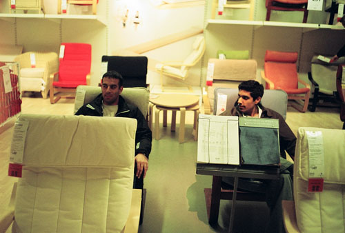 Mez and Rishi test driving chairs at Ikea.