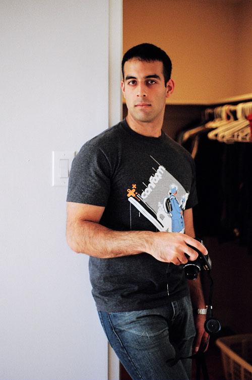 Mezan standing in front of my walk-in closet.