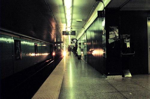 The subway arrives at a subway station.