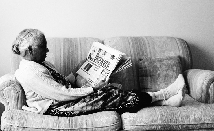 My grandmother sitting on the love seat in my living room.