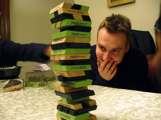 Dave playing Jenga in my dining room.