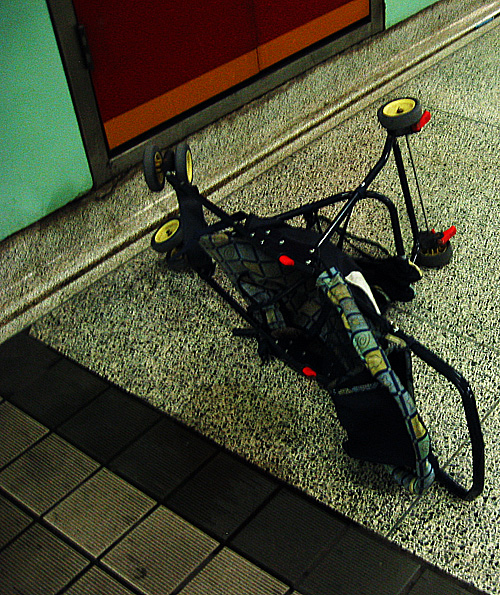 A pram on its side in St. Patrick station.