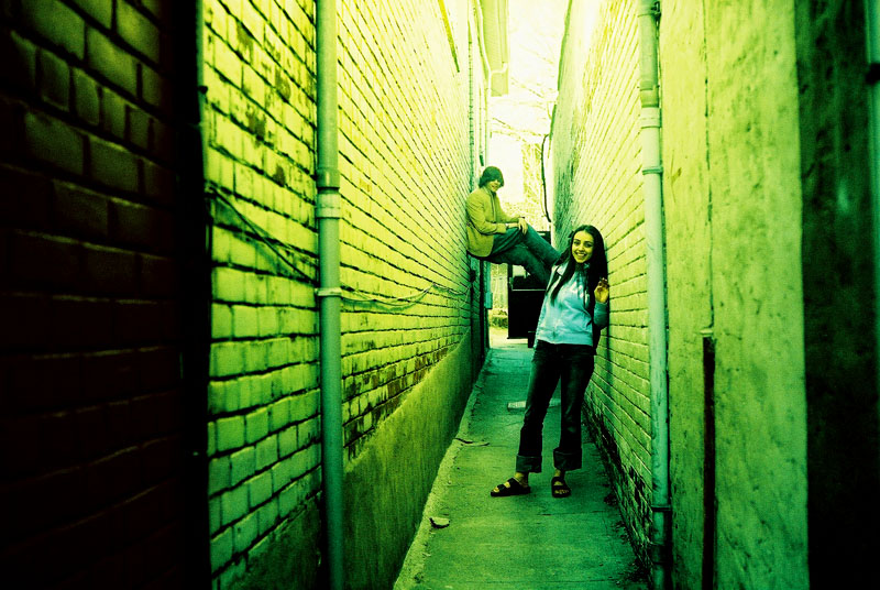 Tyler and Shima in an Alley.