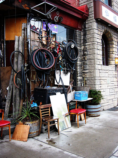 A bicycle repair shop next to Clafouti.
