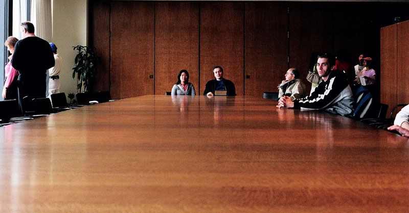 Carvill and Dave sitting at the head of the TD towers boardroom table.