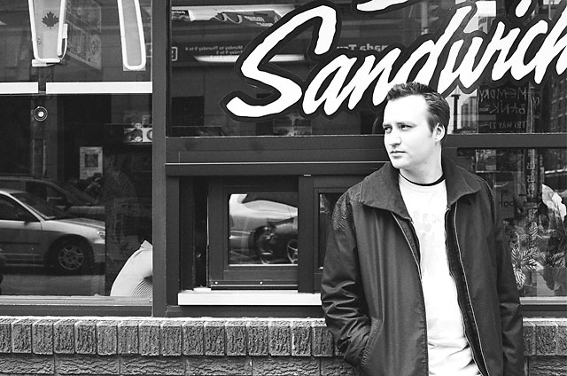 Dave leaning against the McDonald's window at Spadina.
