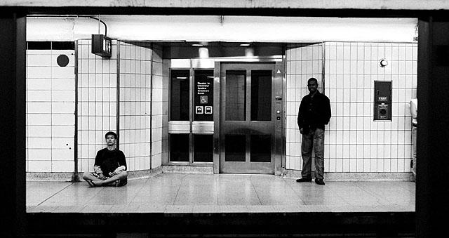 Bahi standing on the East bound platform at Spadina Station.