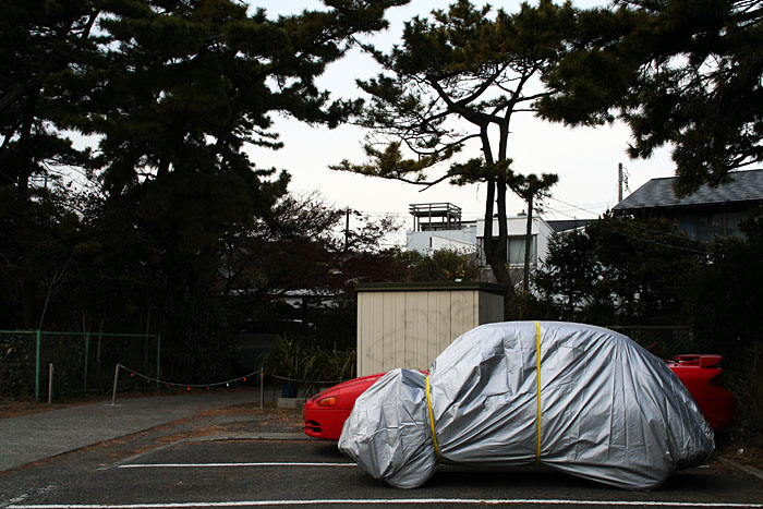 A small car, all wrapped up, in Kamakura.