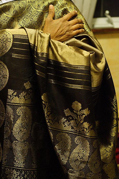 My Mom holding a sari up.