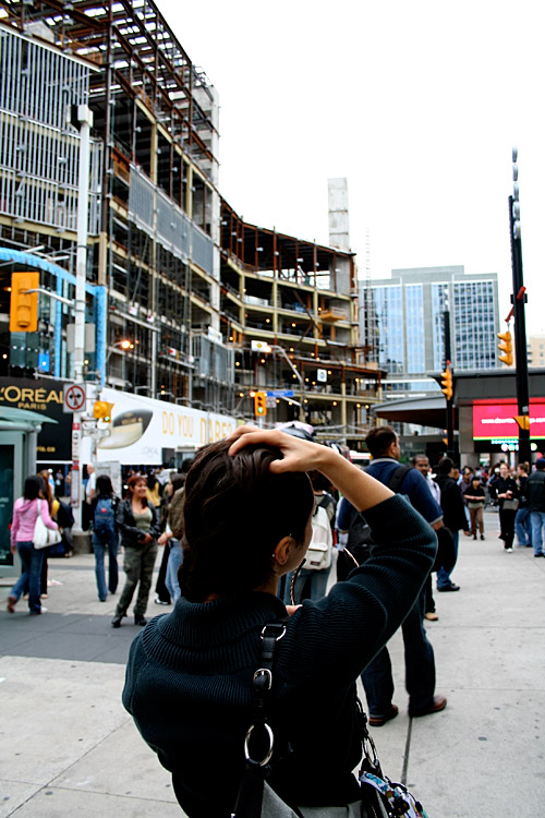 Shima looks distraught over the construction and Yonge and Dundas.